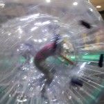 Climbing like a hamster inside the inflatable ball!