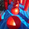 Try your best not to fall off the large, inflatable balls!